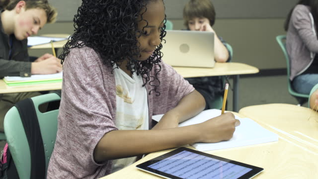 close-up shot of african american student writing - junior high stock videos & royalty-free footage