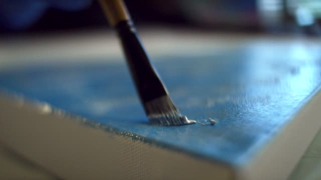 close-up shot of an artist dabbing oil paint on to a canvas in an indoor art studio - canvas stock videos & royalty-free footage