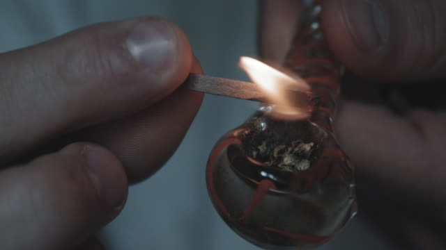 closeup shot of an unrecognizable caucasian man smoking marijuana - 4k - smoking issues stock videos and b-roll footage