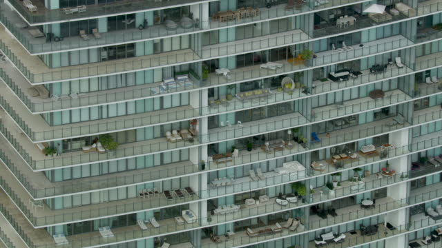 close-up shot of apogee condo building balconies in miami - 集合住宅点の映像素材/bロール
