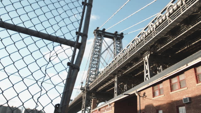 closeup shot of brooklyn's williamsburg bridge before sunset - chainlink fence stock videos and b-roll footage
