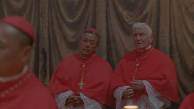 close-up shot of catholic cardinals gathered in a meeting. - ヴァチカン市国点の映像素材/bロール