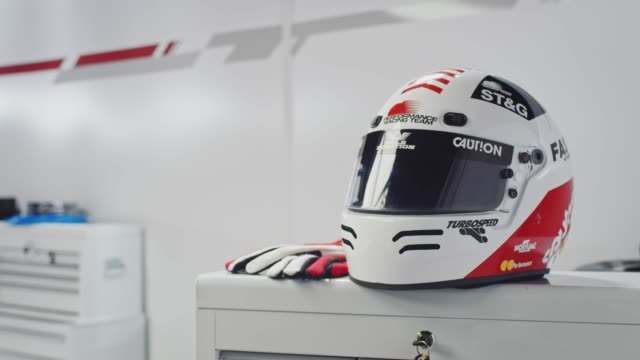 close-up shot of crash helmet and gloves in lab - crash helmet stock videos and b-roll footage