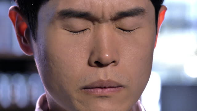 close-up shot of facial expression of a man - korea stock-videos und b-roll-filmmaterial