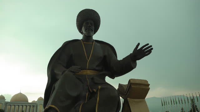 close-up shot of famous warrior statue in independence park against clear sky - ashgabat, turkmenistan - priest stock videos & royalty-free footage