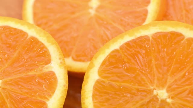 closeup shot of fresh orange slices - tangerine stock videos and b-roll footage
