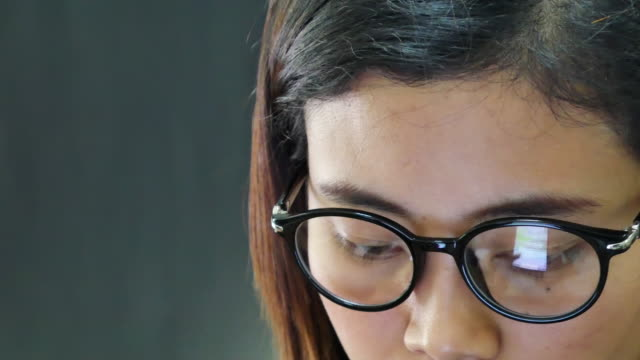 Closeup shot of girl in glasses surfing internet