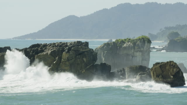 close-up shot of huge rocks at the coastline of haast - new zealand stock videos & royalty-free footage