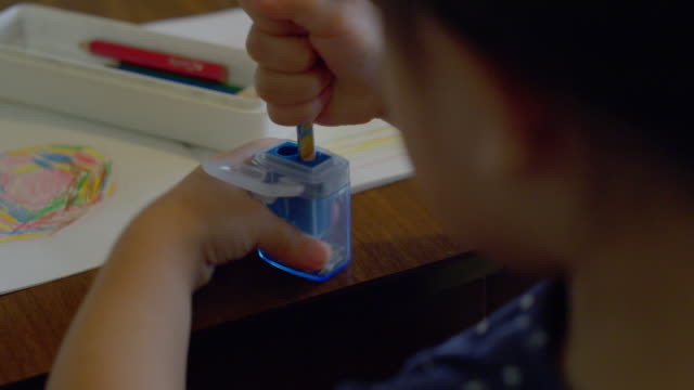 close-up shot of little girl sharpen a colored pencil - colored pencil stock videos and b-roll footage