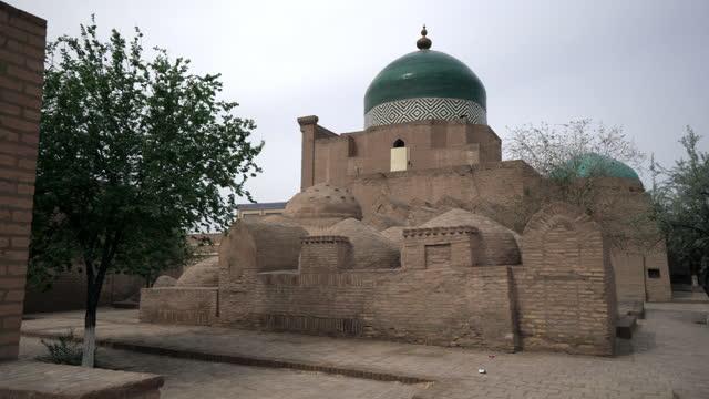 close-up shot of maqbara-i pahlavan mahmoud against clear sky - khiva, uzbekistan - temple building stock videos & royalty-free footage