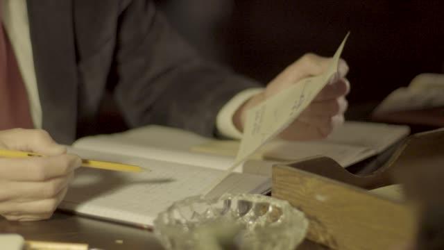 close-up shot of men examining financial records - reenactment stock videos & royalty-free footage