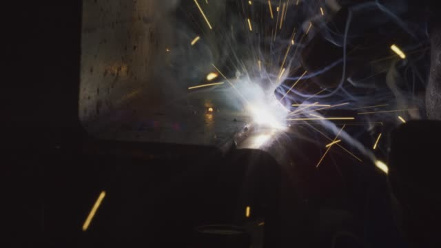 close-up shot of mig welding with sparks - welding helmet stock videos & royalty-free footage