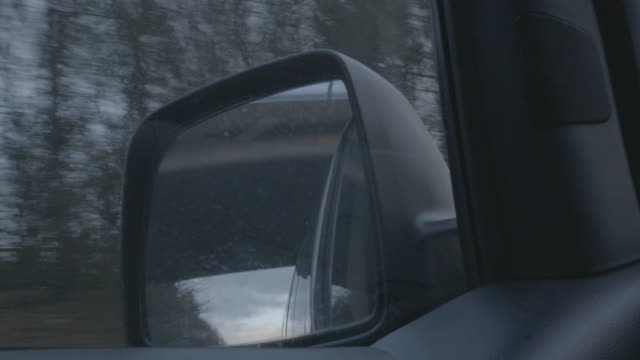 close-up shot of moving trees and sky reflecting in a side-view mirror - エセックス州点の映像素材/bロール