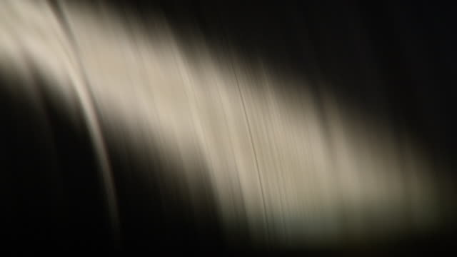 close-up shot of paper rolling through a printing press, uk. - drehen stock-videos und b-roll-filmmaterial