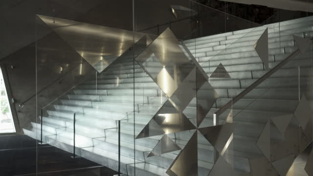 close-up shot of pattered glass wall in modern space - porto, portugal - reflection stock videos & royalty-free footage