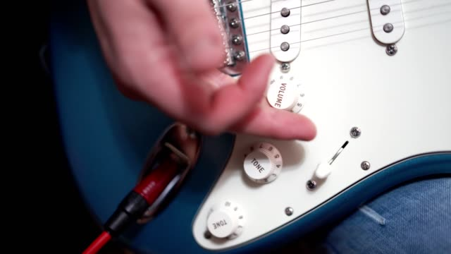 close-up shot of plug in the cable in to the guitar - interconnect plug stock videos & royalty-free footage