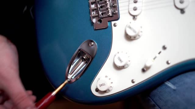 close-up shot of plug in the cable in to the guitar - amplifier stock videos & royalty-free footage