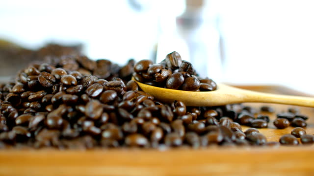Close-up Shot of Roasted Coffee Beans with Wooden Spoon