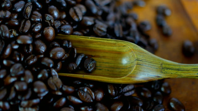 close-up shot of roasted coffee beans with wooden spoon - serving scoop stock videos & royalty-free footage