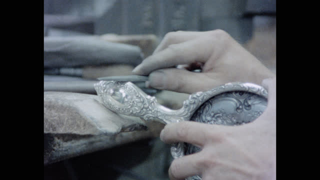 close-up shot of senior man's hands polishing silver mirror with tool in the gorham factory, rhode island, new england, usa - antique stock videos & royalty-free footage