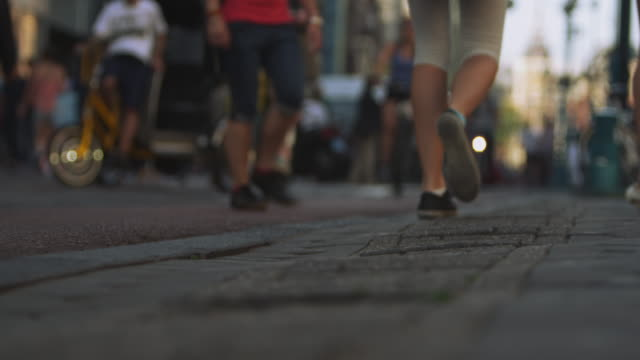 close-up shot of sidewalk on amsterdam - kopfsteinpflaster stock-videos und b-roll-filmmaterial
