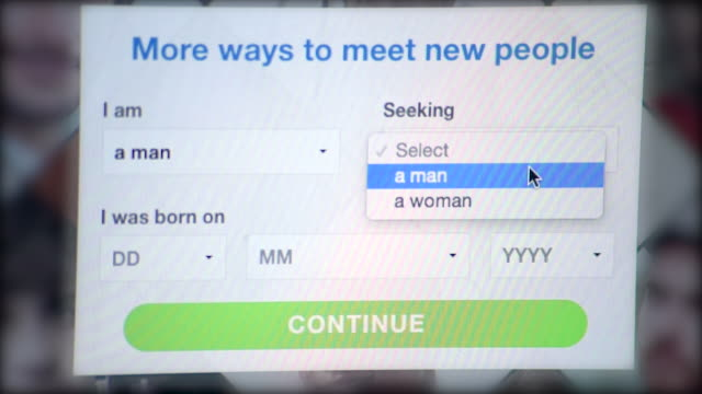 stockvideo's en b-roll-footage met close-up shot of signing up to a dating website as a man interested in men. - profiel