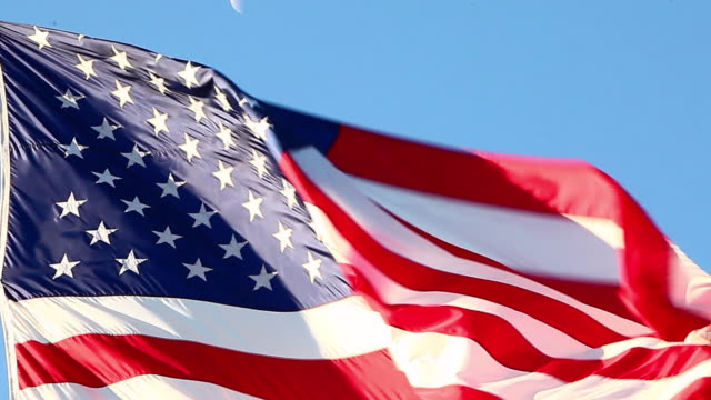 close-up shot of the american flag flying over the korean war veterans memorial in washington dc - stars and stripes stock videos & royalty-free footage