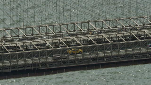 close-up shot of the brooklyn bridge with traffic - brooklyn bridge stock videos and b-roll footage