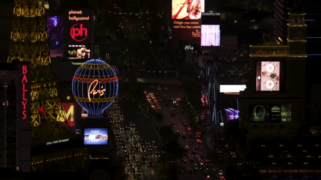 close-up shot of the eiffel tower restaurant and the montgolfier balloon replica in las vegas at night - replica eiffel tower stock videos & royalty-free footage