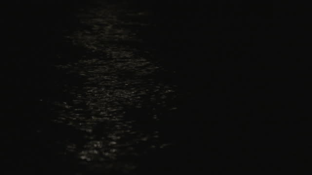 close-up shot of the light reflecting on the water at night - anchorage alaska stock videos & royalty-free footage