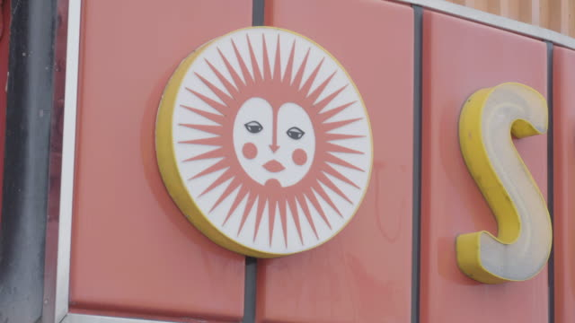 close-up shot of  the neon sign of the sunspot amusements on marine parade in southend-on-sea - logo stock videos & royalty-free footage