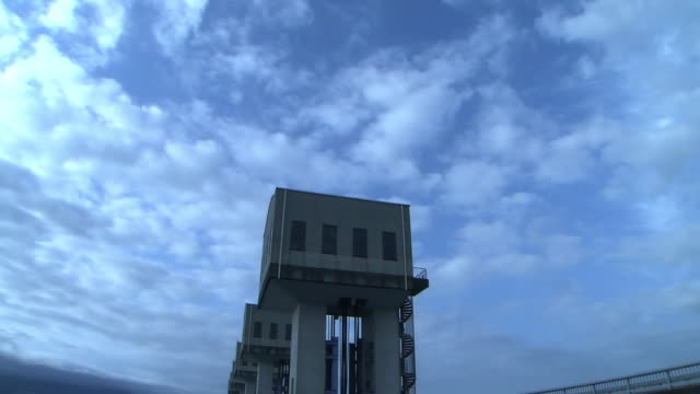 closeup shot of the north tide gate no 6 of isahaya bay on the ariake sea built by the government's reclamation project under the overcast sky in the... - ariake sea stock videos and b-roll footage