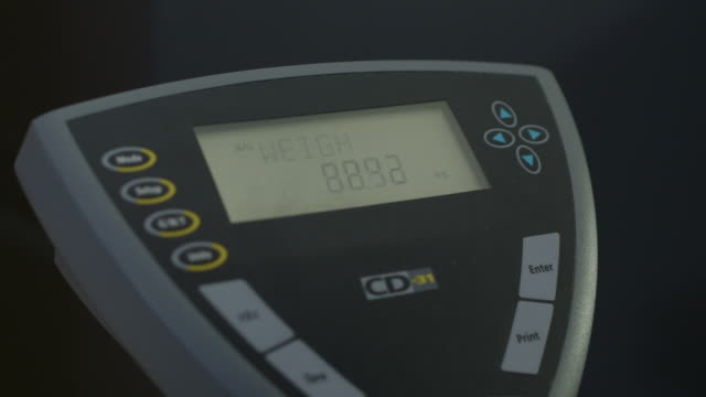close-up shot of the screen of digital weighing scales as someone steps onto and off them, uk. - scales stock videos & royalty-free footage