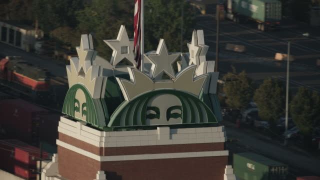 close-up shot of the starbucks sign at the top of the starbucks corp. office building - seattle coffee stock videos and b-roll footage