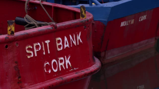 close-up shot of the sterns of small fishing boats moored in cobh, county cork, ireland. - cork material stock videos & royalty-free footage