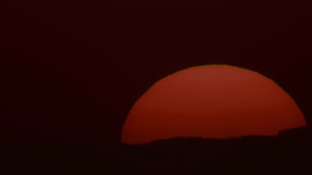 t/l close-up shot of the sun rises behind the hill - hill stock videos & royalty-free footage