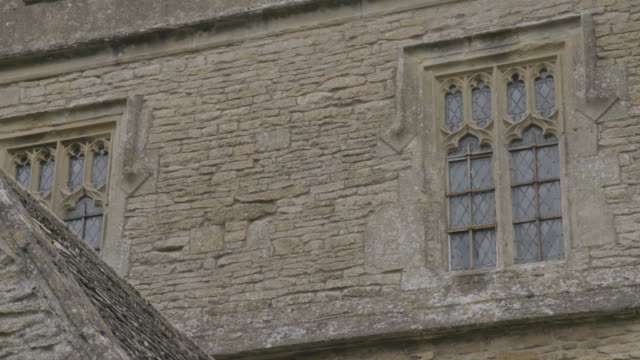 close-up shot of the windows of the st peter and st paul c of e church in long compton - ornate stock videos & royalty-free footage