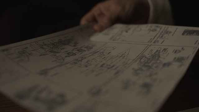 vídeos y material grabado en eventos de stock de close-up shot of two men looking over documents in front of the desk - plano documento