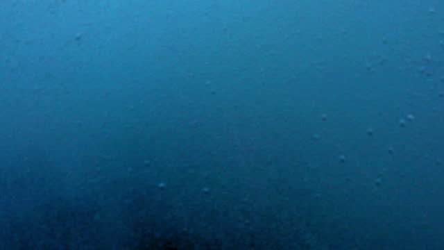 close-up shot of waves and bubbles splashing underwater - oahu, hawaii - oahu stock videos & royalty-free footage