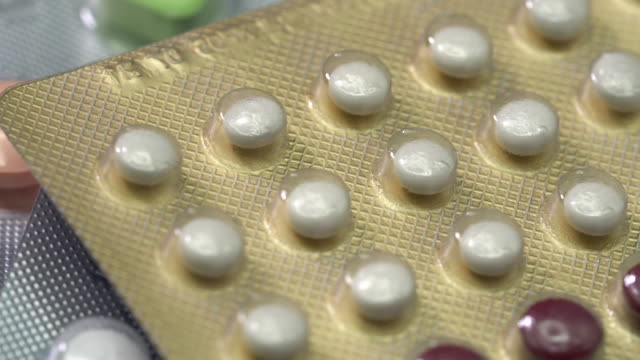 closeup shot of white medical turning - contraceptive stock videos & royalty-free footage