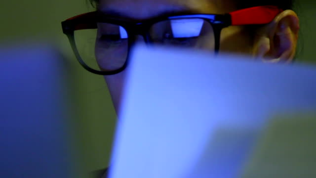 closeup shot of woman in glasses surfing internet at night:1920x1080 full hd - biomedical illustration stock videos & royalty-free footage
