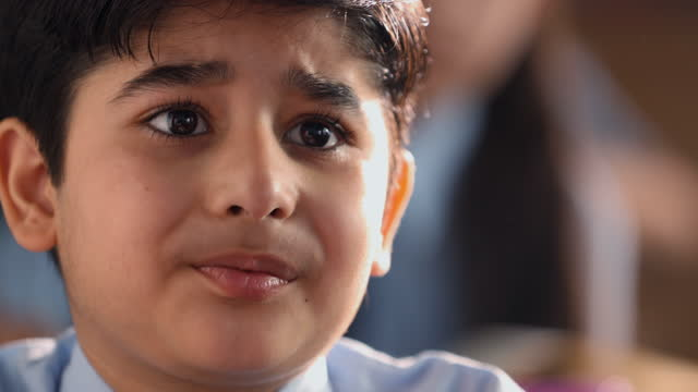 close-up shot of worried boy sitting in classroom - fear stock videos & royalty-free footage