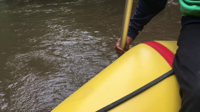 close-up shot rafting in river, thailand. - dinghy stock videos & royalty-free footage