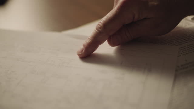 close-up shot reenactment of a hand of a man pointing out on a blueprint during the 1980s - document stock videos & royalty-free footage