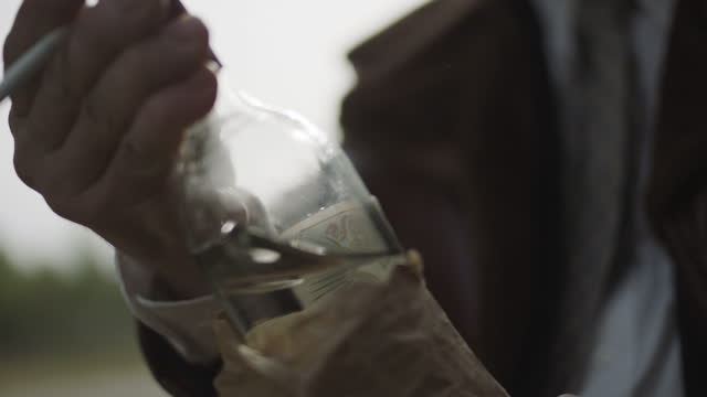 close-up shot of a man giving a bottle in a paper bag to another one - former soviet union stock videos & royalty-free footage