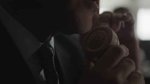 close-up shot of a man talking on the telephone in the office - produced segment stock videos & royalty-free footage