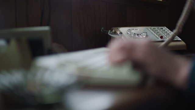 close-up shot of the hands of a woman picking up the telephone receiver while typing on keyboards in the office - secretary stock videos & royalty-free footage