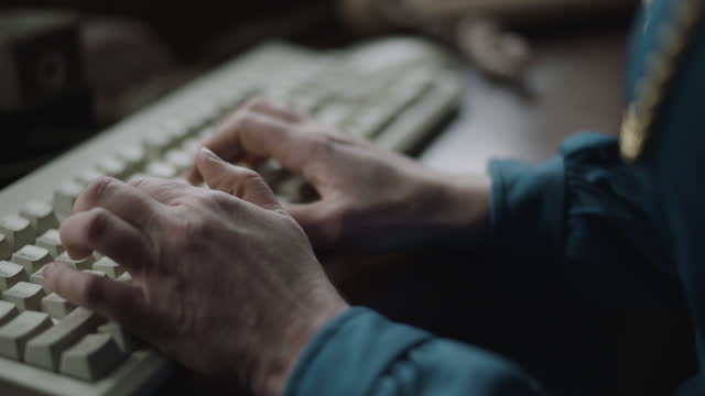 close-up shot of the hands of a woman typing on keyboards in the office - secretary stock videos & royalty-free footage