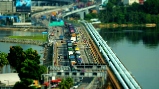closeup shot time lapse of a busy traffic at the singapore causeway bridge - johor stock videos & royalty-free footage