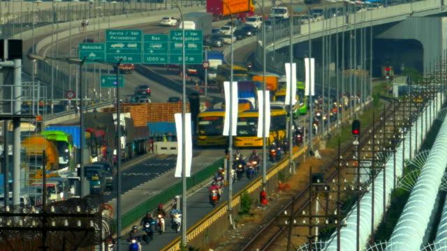closeup shot time lapse of a busy traffic at the singapore causeway bridge - causeway stock videos & royalty-free footage